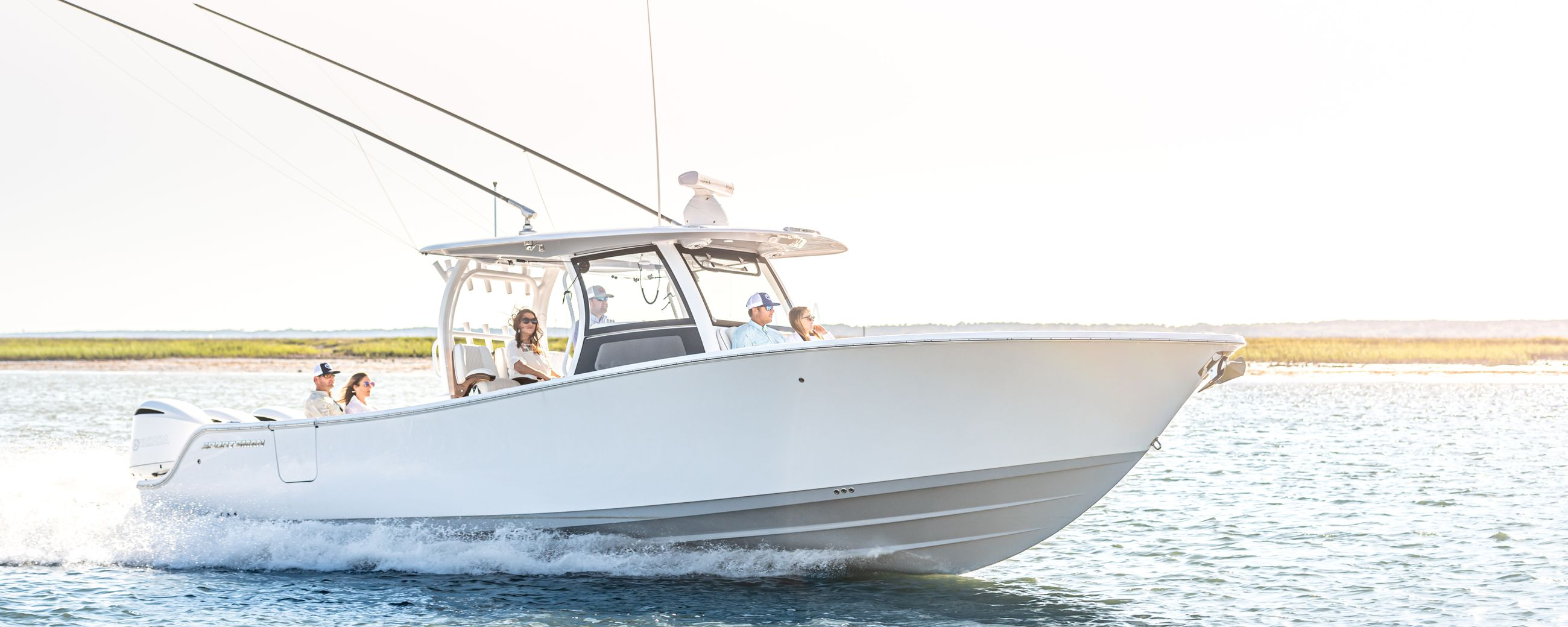 The all-new Open 352 Center Console running on the water with a family on board